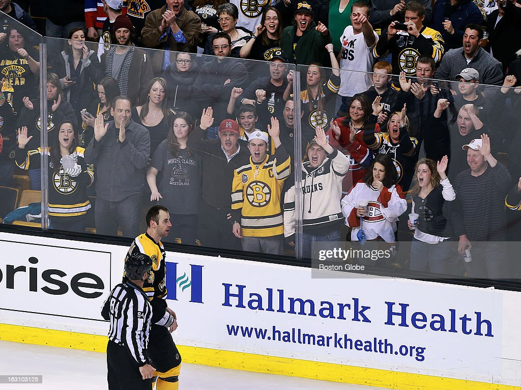 Fans cheer as the Bruins' Zdeno Chara is escorted off the ice for 17 minutes in penalties for fighting the Canadiens' Alexei Emelin, not pictured, in retaliation after he hit the Bruins' Tyler Seguin with his stick and sent him to the locker room in the second period. The Boston Bruins hosted the Montreal Canadiens in a regular season NHL hockey game at the TD Garden.