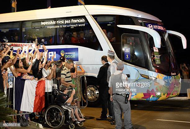 Fans cheer as the bus carrying the French national football team arrives at the JP Hotel which will host the French national football team during the...