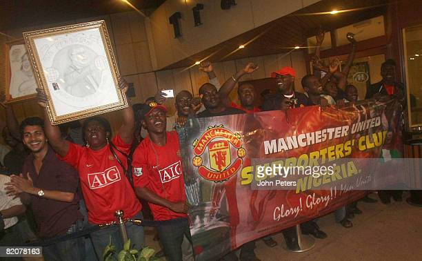 Fans cheer as The Manchester United squad arrive in Abuja ahead of their preseason friendly match againsy Portsmouth during their preseason tour to...