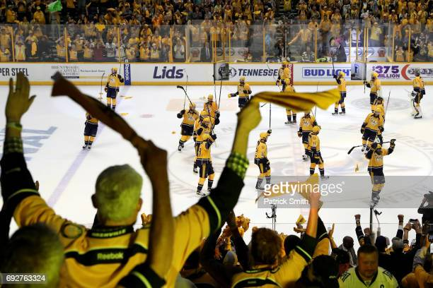 Fans cheer as the Nashville Predators celebrate after defeating the Pittsburgh Penguins with a score of 4 to 1 in Game Four of the 2017 NHL Stanley...