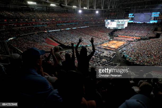 Fans cheer as the North Carolina Tar Heels take on the Gonzaga Bulldogs in the first half during the 2017 NCAA Men's Final Four National Championship...
