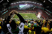 Fans cheer as the Oregon Ducks take the field prior to the College Football Playoff National Championship Game against the Ohio State Buckeyes at ATT...