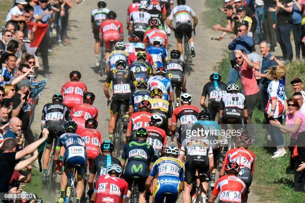 Fans cheer as the pack ride on the cobblestones during the 115th edition of the ParisRoubaix oneday classic cycling race between Compiegne and...