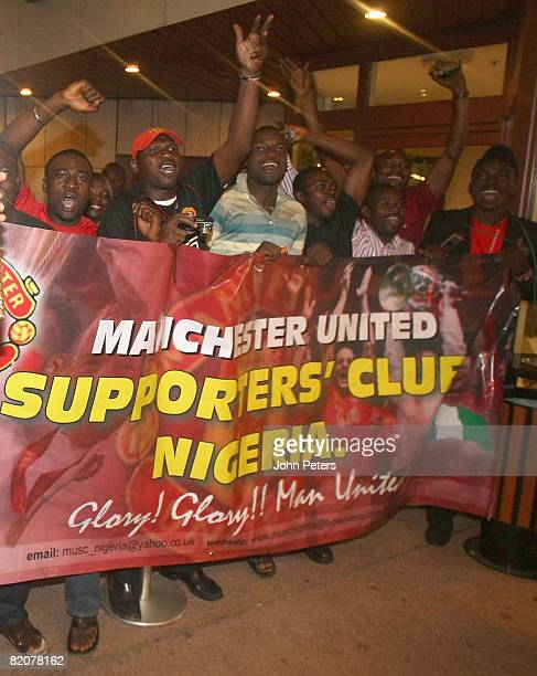 Fans cheer as the The Manchester United squad arrive in Abuja ahead of their preseason friendly match againsy Portsmouth during their preseason tour...