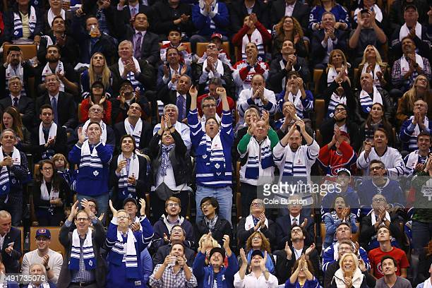 TORONTO ON OCTOBER 7 Fans cheer as the Toronto Blue Jays are displayed on the screen at the Toronto Maple Leafs game at the ACC during their hockey...