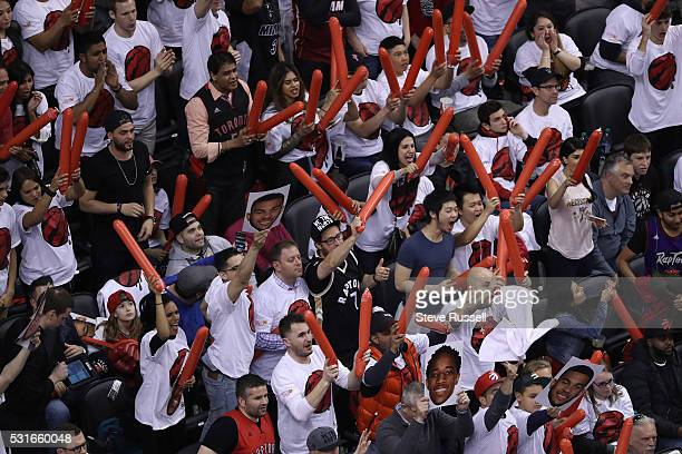 Fans cheer as the Toronto Raptors beat the Miami Heat in game seven of their Eastern Conference Semifinal at the Air Canada Centre in Toronto May 15...
