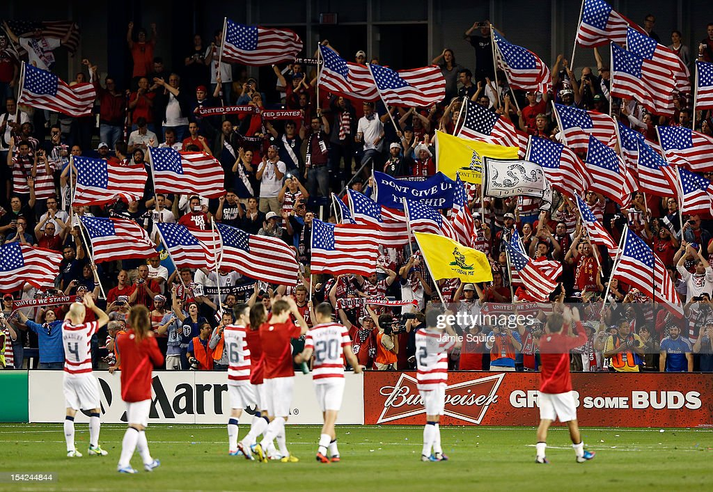 Fans cheer as the USA team applauds them after the USA defeated Guatemala 3-1 to win the World Cup Qualifying match at LiveStrong Sporting Park on October 16, 2012 in Kansas City, Kansas.