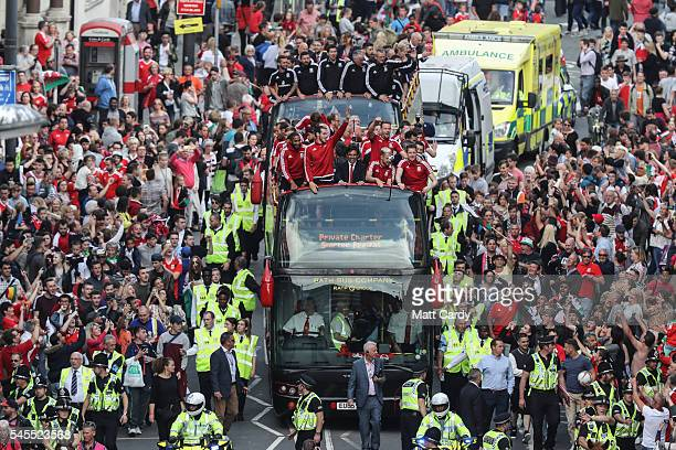 Fans cheer as they line Westgate Street to welcome the Wales team home following their exit from the Euro 2016 championships on July 8 2016 in...