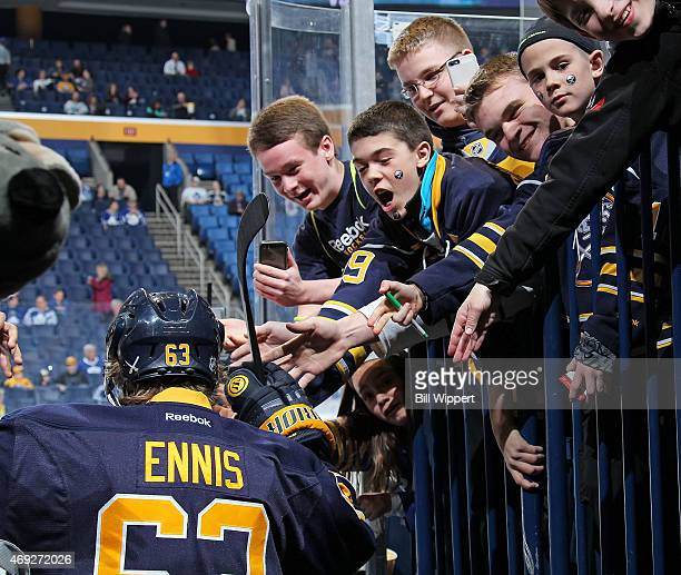 Fans cheer as Tyler Ennis of the Buffalo Sabres heads to the ice for a game against the Toronto Maple Leafs on April 1 2015 at the First Niagara...