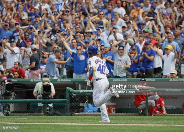 Fans cheer as Willson Contreras of the Chicago Cubs runs the bases after hitting a two run home run in the 6th inning against the Washington...