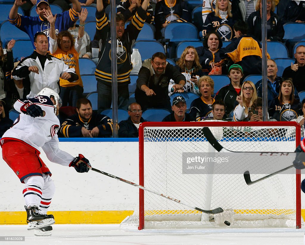 Fans cheer as Zemgus Girgensons #28 of the Buffalo Sabres (not shown) scores an empty net goal past <a gi-track='captionPersonalityLinkClicked' href=/galleries/search?phrase=David+Savard&family=editorial&specificpeople=4630692 ng-click='$event.stopPropagation()'>David Savard</a> #58 of the Columbus Blue Jackets during their preseason game at First Niagara Center on September 25, 2013 in Buffalo, New York. Buffalo defeated Columbus, 3-0.