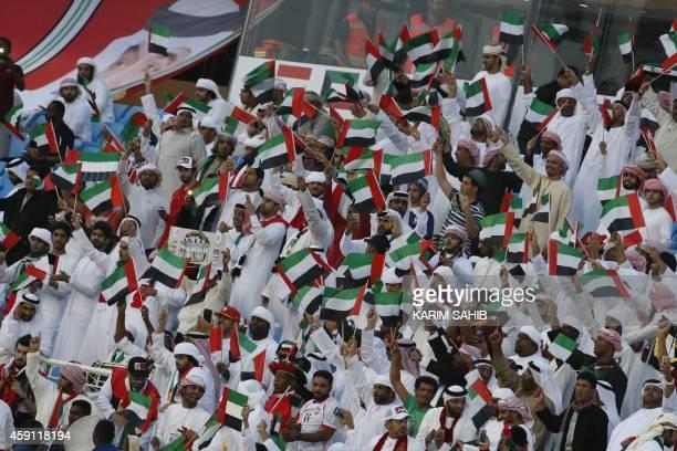 UAE fans cheer before a match against Kuwait during their Gulf Cup Group B football match at the Prince Faisal bin Fahad Stadium in Riyadh on...
