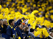 Fans cheer during a game between the Michigan Wolverines and Penn State Nittany Lions on October 11 2014 at Michigan Stadium in Ann Arbor Michigan