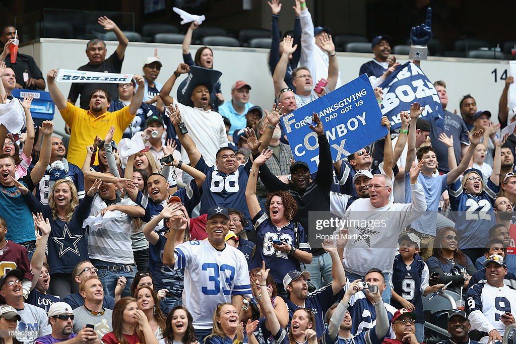 Fans cheer during a game between the Washington Redskins and the Dallas Cowboys at Cowboys Stadium on November 22, 2012 in Arlington, Texas.