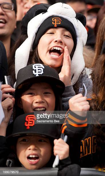 Fans cheer during a parade to celebrate the San Francisco Giants' 2012 World Series Championship in downtown San Francisco California on Wednesday...