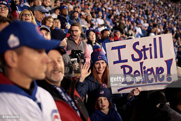 Fans cheer during Game Five of the 2016 World Series between the Chicago Cubs and the Cleveland Indians at Wrigley Field on October 30 2016 in...