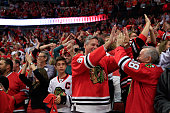 Fans cheer during Game Four of the 2015 NHL Stanley Cup Final between the Chicago Blackhawks and the Tampa Bay Lightning at the United Center on June...