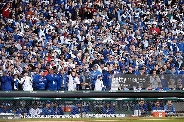 Fans cheer during game four of the National League Division Series between the Chicago Cubs and the St Louis Cardinals at Wrigley Field on October 13...