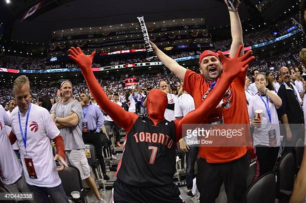 Fans cheer during Game One of the Eastern Conference Playoffs Washington Wizards against the Toronto Raptors at the Air Canada Centre on April 18...