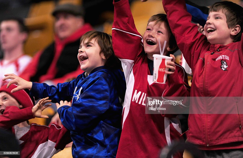 Fans cheer during the Beanpot Tournament consolation game between Northeastern University and Harvard University at TD Garden on February 8, 2016 in Boston, Massachusetts.