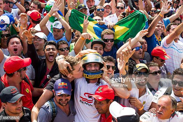 Fans cheer during the Brazilian Formula One Grand Prix at Autodromo Jose Carlos Pace on November 9 2014 in Sao Paulo Brazil