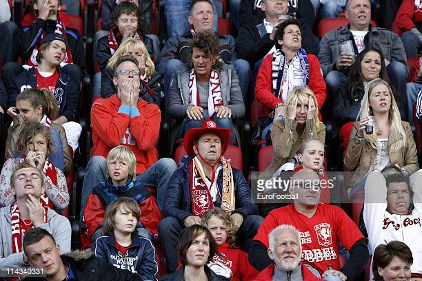 Fans cheer during the Eridivisie match between Ajax Amsterdam and FC Twente at the Amsterdam Arena on May 15 2010 in Amsterdam The Netherlands