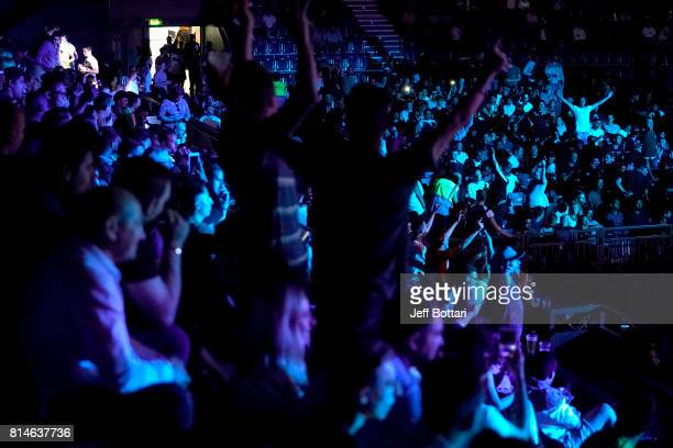 Fans cheer during the Floyd Mayweather Jr v Conor McGregor World Press Tour event at SSE Arena on July 14 2017 in London England