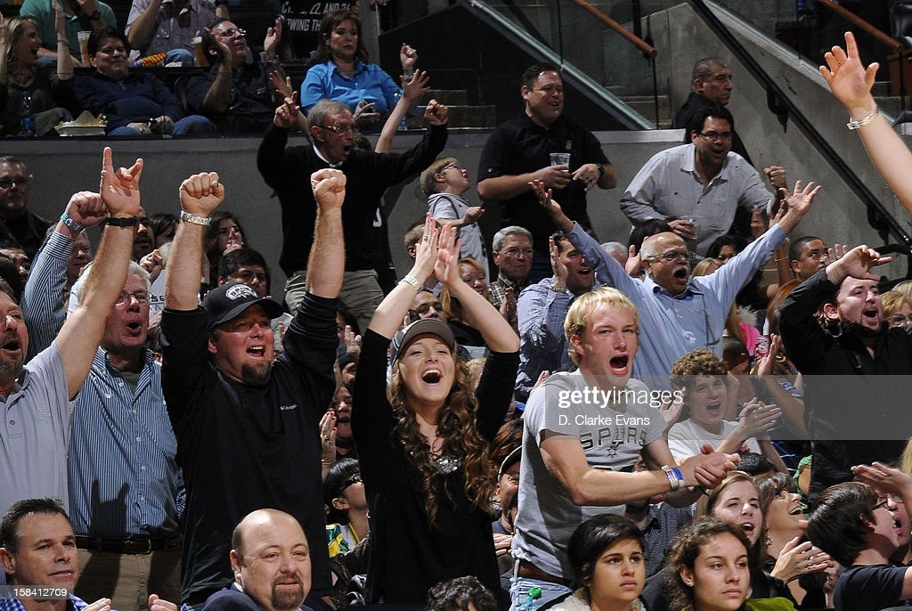 Fans cheer during the game between the Boston Celtics and the San Antonio Spurs on December 15, 2012 at the AT&T Center in San Antonio, Texas.