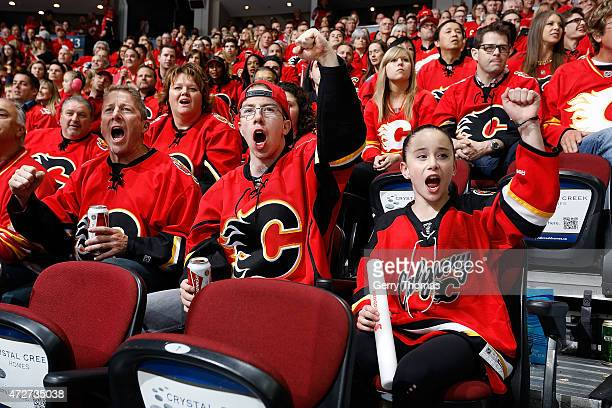 Fans cheer during the game between the Calgary Flames and the Anaheim Ducks at Scotiabank Saddledome for Game Four of the Western Quarterfinals...