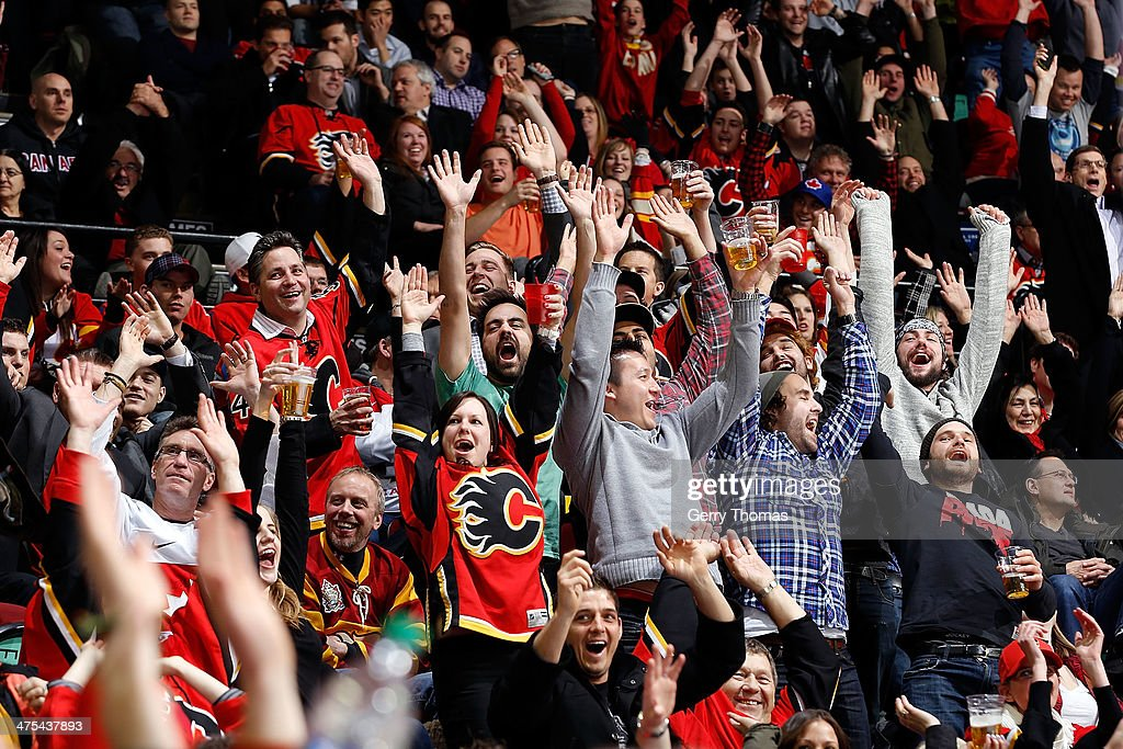 Fans cheer during the game between the Calgary Flames and the Los Angeles Kings at Scotiabank Saddledome on February 27, 2014 in Calgary, Alberta, Canada.
