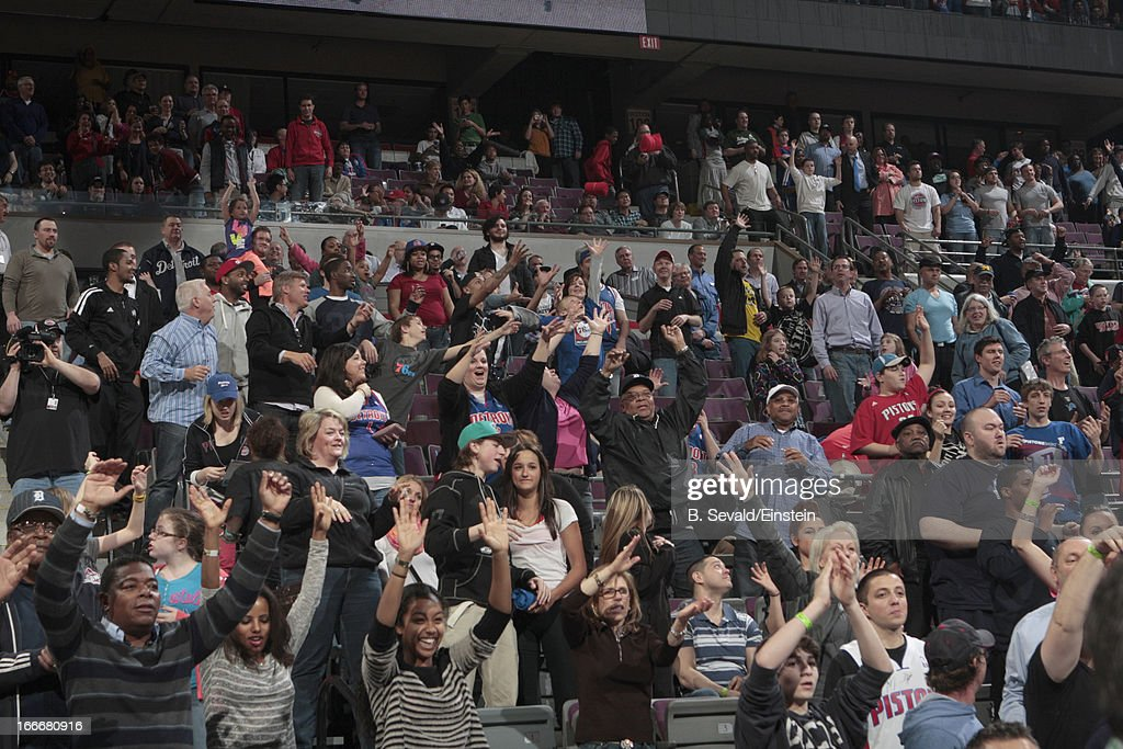 Fans cheer during the game between the Detroit Pistons and the Philadelphia 76ers on April 15, 2013 at The Palace of Auburn Hills in Auburn Hills, Michigan.