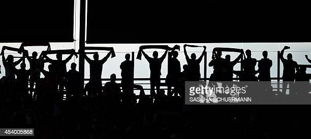Fans cheer during the German first division Bundesliga football match 1 FC Koeln v Hamburger SV at Rhein Energie stadium in Cologne Germany on August...