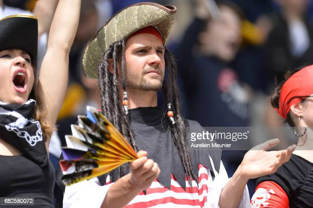Fans cheer during the HSBC rugby sevens match between France and Kenya on May 13 2017 in Paris France