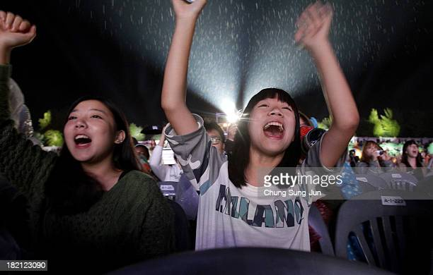 Fans cheer during the KPOP festival hosted by Visit Korea Committee on September 28 2013 in Wonju South Korea KPOP Festival in Gangwon 2013 is a...