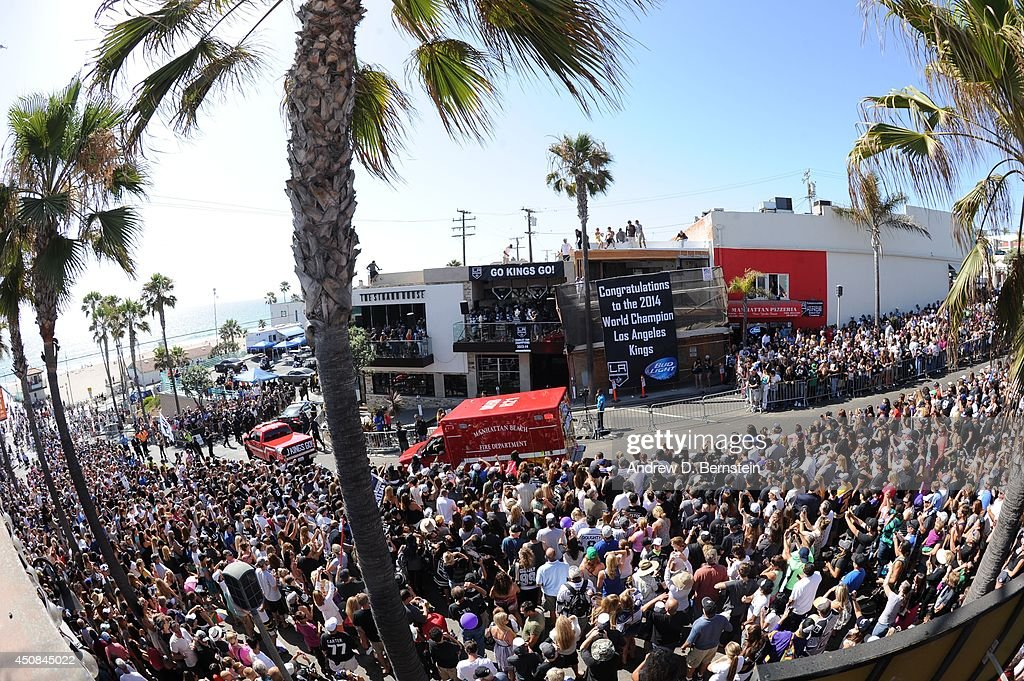 Fans cheer during the Los Angeles Kings South Bay Victory Parade on June 18, 2014 in Manhattan Beach, California.