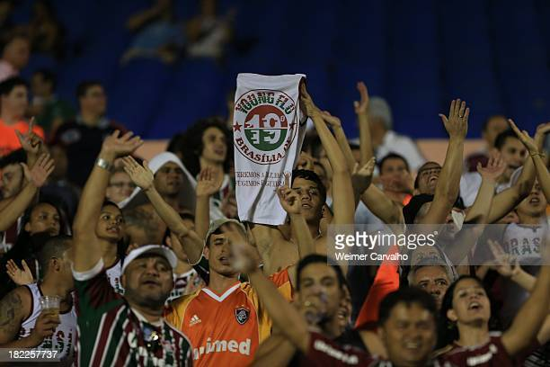 Fans cheer during the match between Goias and Fluminense for the Brazilian Series A 2013 at Serra Dourada stadium on September 28 2013 in Goiania...