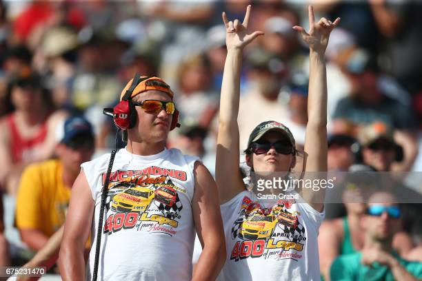 Fans cheer during the Monster Energy NASCAR Cup Series Toyota Owners 400 at Richmond International Raceway on April 30 2017 in Richmond Virginia