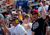Fans cheer during the NASCAR Sprint Cup Series Auto Club 400 at Auto Club Speedway on March 22 2015 in Fontana California