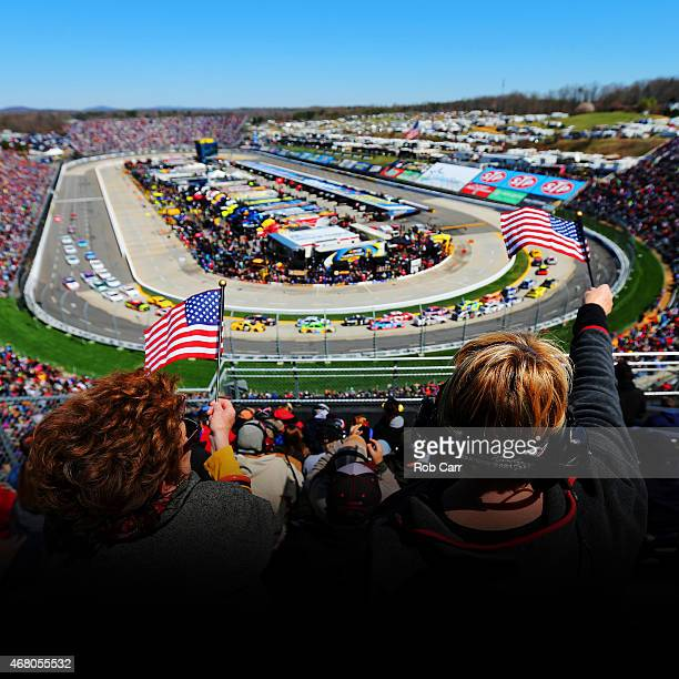 Fans cheer during the NASCAR Sprint Cup Series STP 500 at Martinsville Speedway on March 29 2015 in Martinsville Virginia