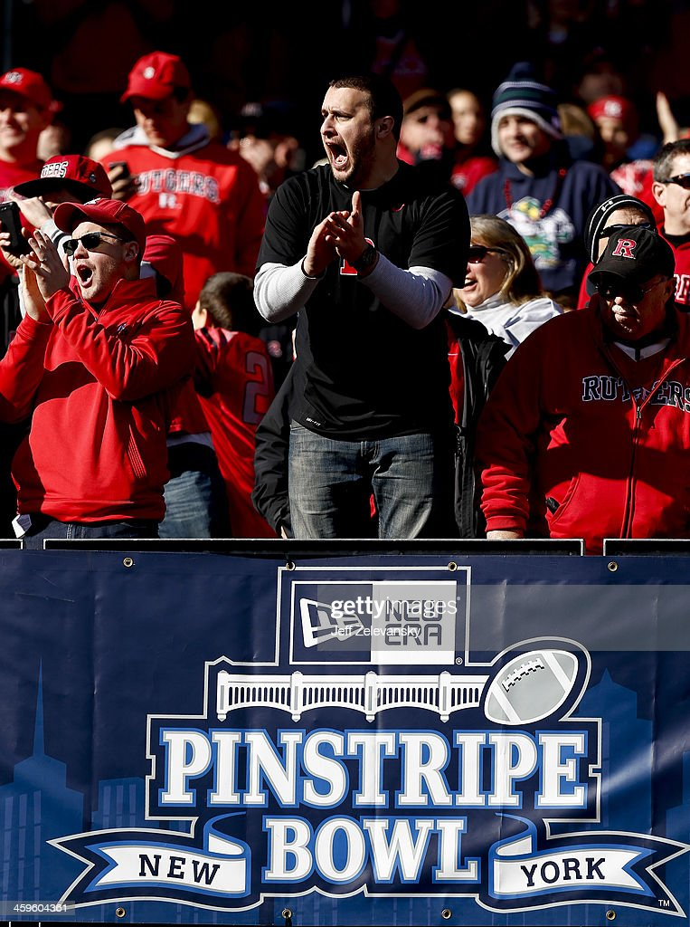 Fans cheer during the New Era Pinstripe Bowl between the Notre Dame Fighting Irish and the Rutgers Scarlet Knights at Yankee Stadium on December 28, 2013 in the Bronx borough of New York City.