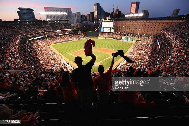 Fans cheer during the sixth inning between the Baltimore Orioles and St Louis Cardinals at Oriole Park at Camden Yards on June 30 2011 in Baltimore...