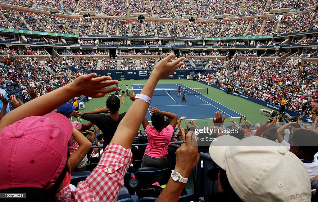 Fans cheer during the Stadium Show on Arthur Ashe Kids' Day prior to the start of the 2012 U.S. Open at the USTA Billie Jean King National Tennis Center on August 25, 2012 in the Flushing neighborhood, of the Queens borough of New York City.