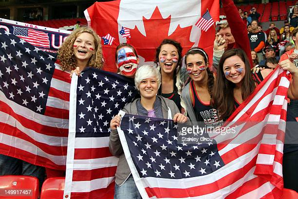 USA fans cheer during the Women's Football Semi Final match between Canada and USA on Day 10 of the London 2012 Olympic Games at Old Trafford on...