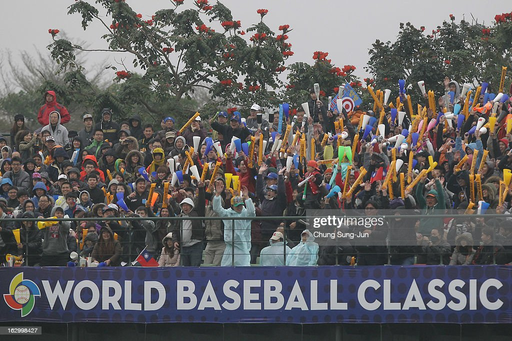 Fans cheer during the World Baseball Classic First Round Group B match between the Netherland and Chinese Taipei at Intercontinental Baseball Stadium on March 3, 2013 in Taichung, Taiwan.