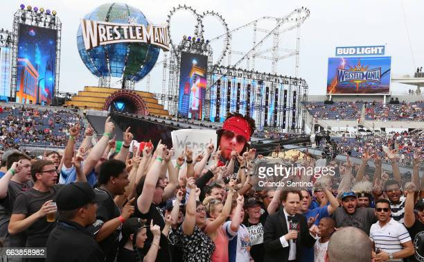 Fans cheer during WrestleMania 33 on Sunday April 2 2017 at Camping World Stadium in Orlando Fla