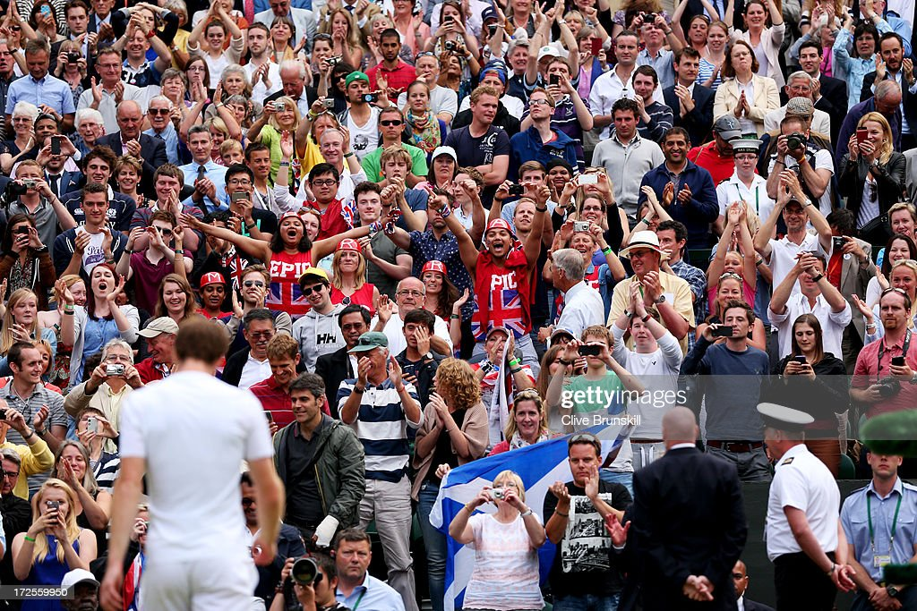 Fans cheer following <a gi-track='captionPersonalityLinkClicked' href=/galleries/search?phrase=Andy+Murray+-+Tennis+Player&family=editorial&specificpeople=200668 ng-click='$event.stopPropagation()'>Andy Murray</a> of Great Britain's victory during the Gentlemen's Singles quarter-final match against Fernando Verdasco of Spain on day nine of the Wimbledon Lawn Tennis Championships at the All England Lawn Tennis and Croquet Club at Wimbledon on July 3, 2013 in London, England.