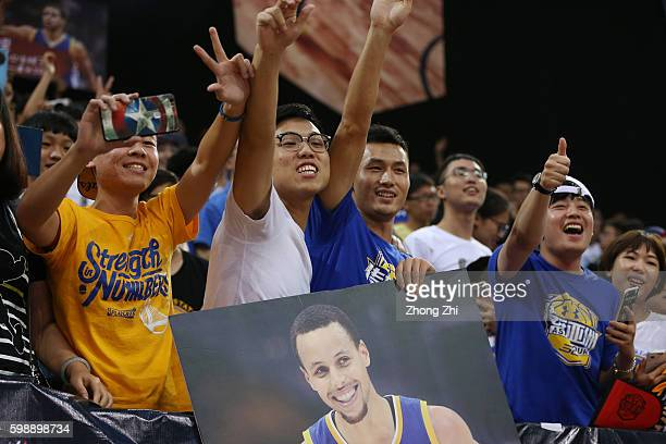 Fans cheer for American professional basketball NBA player Stephen Curry of the Golden State Warriors who attends a commercial event for Under Armour...