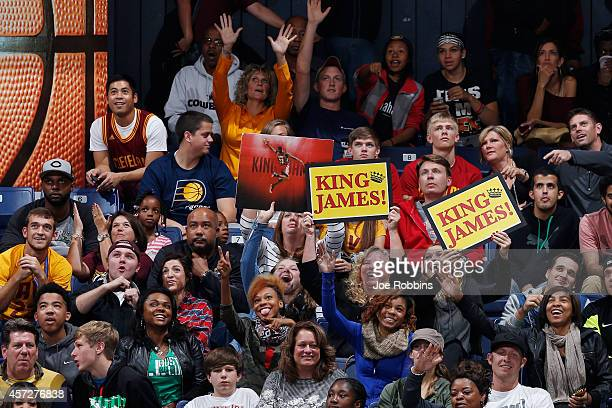 Fans cheer for LeBron James of the Cleveland Cavaliers during the game against the Indiana Pacers at Cintas Center on October 15 2014 in Cincinnati...