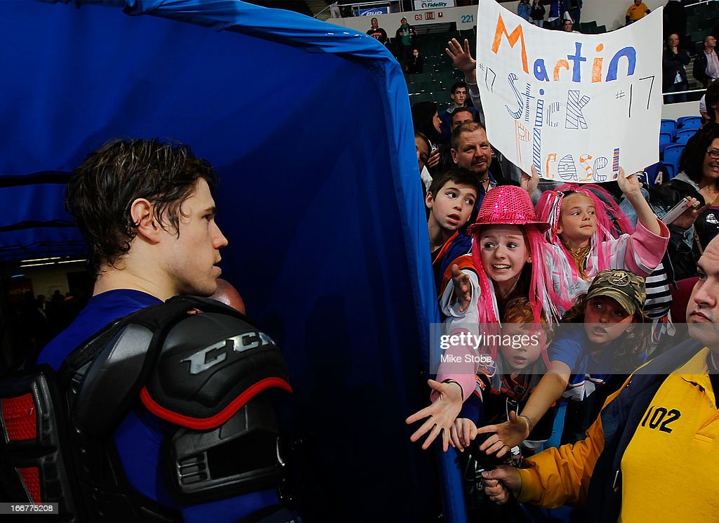 Fans cheer for Matt Martin #17 of the New York Islanders after the game against the Florida Panthers at Nassau Veterans Memorial Coliseum on April 16, 2013 in Uniondale, New York. The New York Islanders defeated the Florida Panthers 5-2.