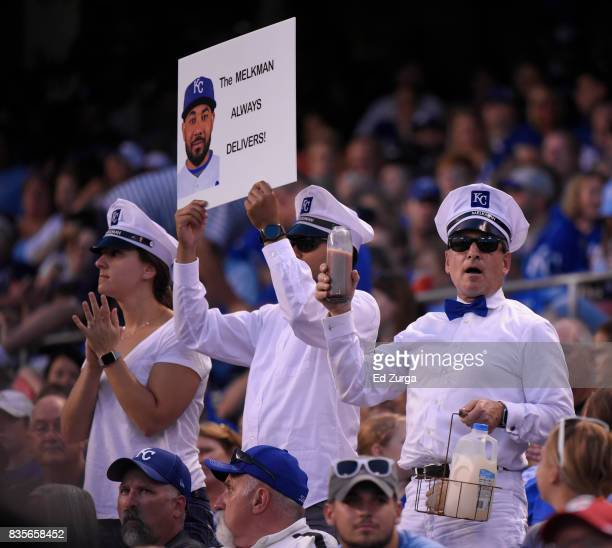 Fans cheer for Melky Cabrera of the Kansas City Royals as he comes up to bat in the sixth inning against the Cleveland Indians at Kauffman Stadium on...